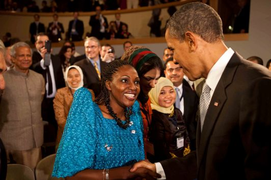 Rehmah Kasule with U.S. President Barack Obama. Photo by Pete Souza.